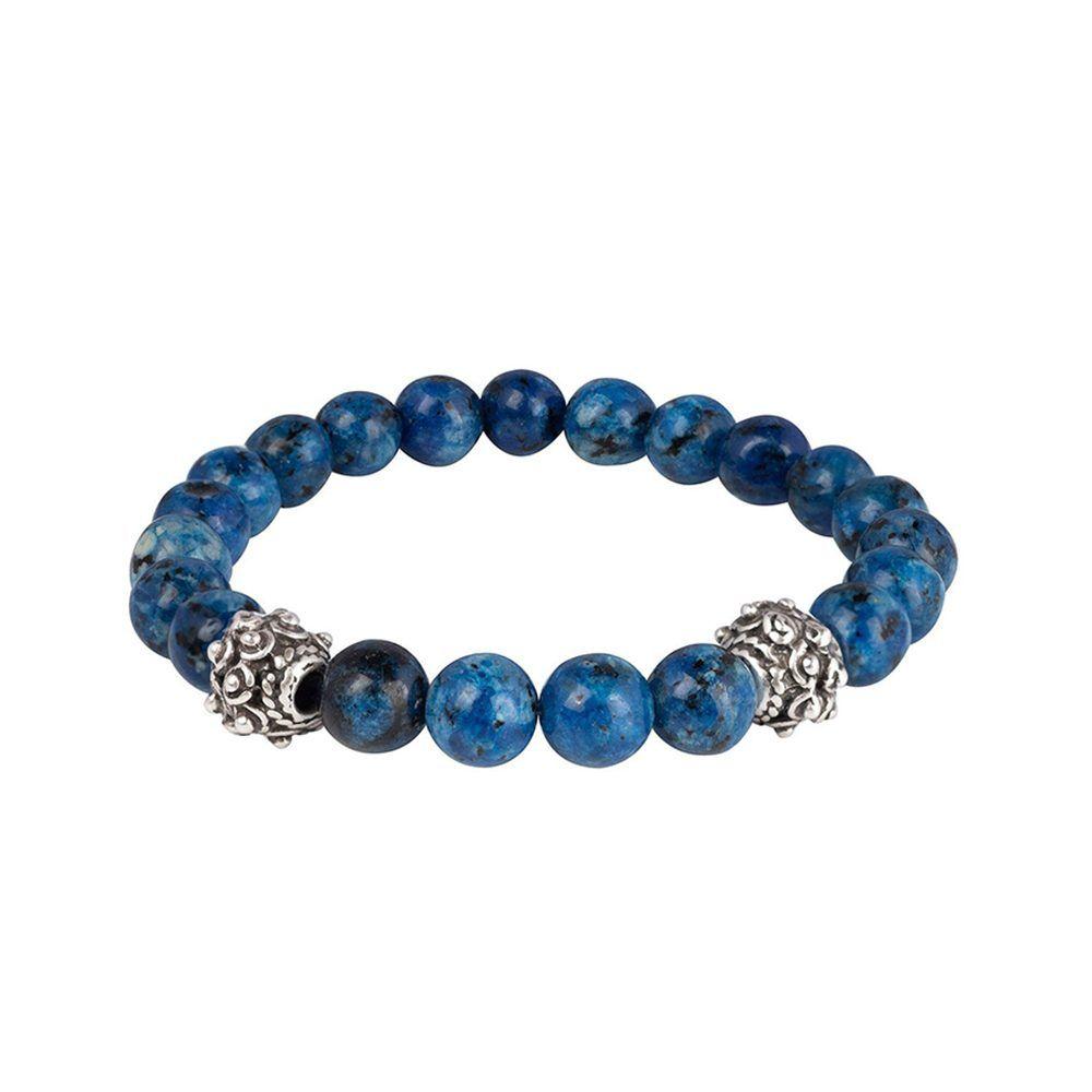 Pulsera con piedras semi-preciosas azules y piezas ornamentadas metálicas.
