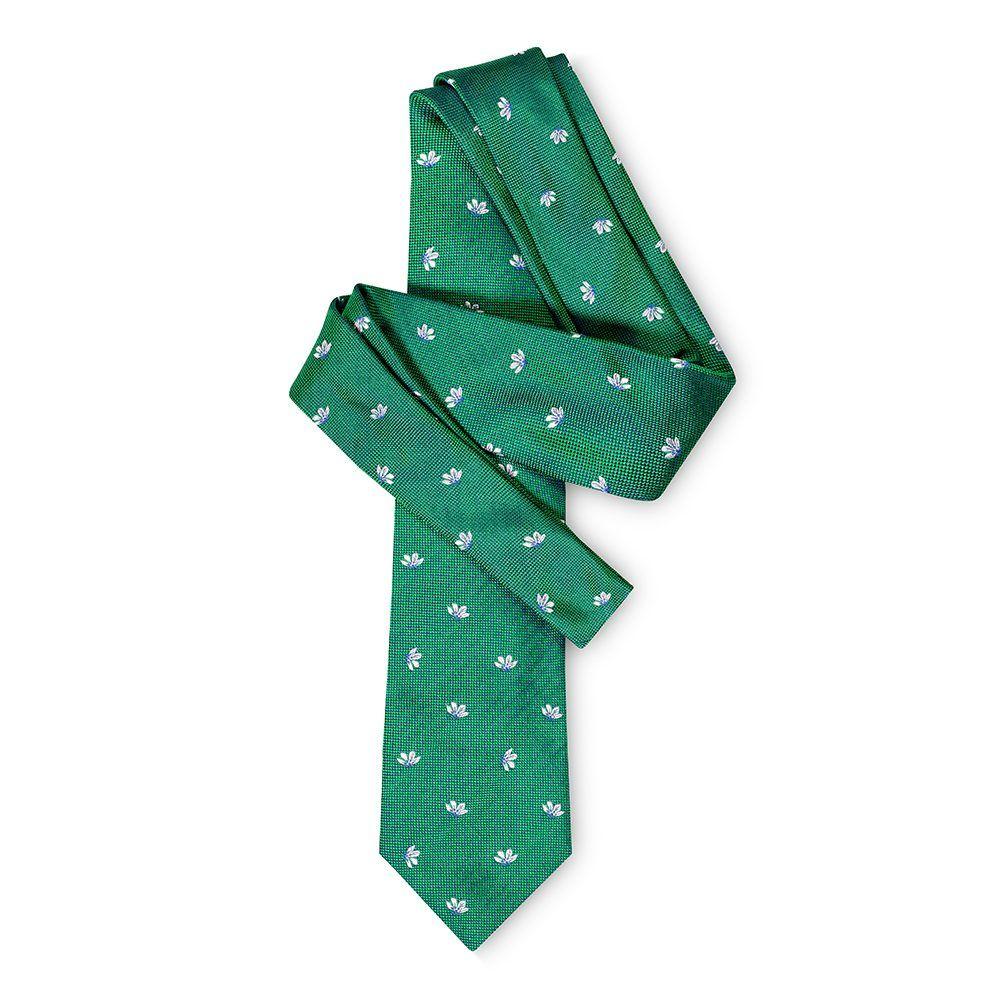 Corbata verde con flores blancas en jacquard seda de origen Español.