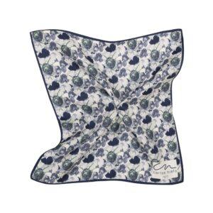 Pañuelo azul oscuro con estampado floral acuarelado y marco azul en seda de origen Español.