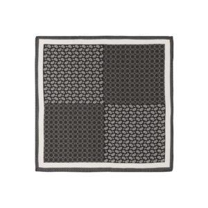 Pañuelo negro con estampado de círculos, puntos y arabescos, cenefa blanca y marco en seda de origen Español.