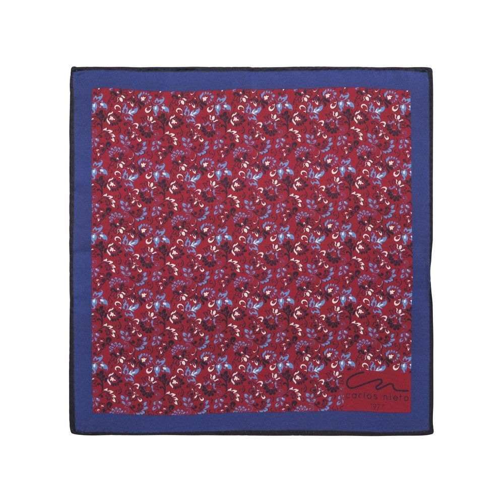 Pañuelo vino tinto con estampado floral y cenefa angosta azul en seda de origen Español.
