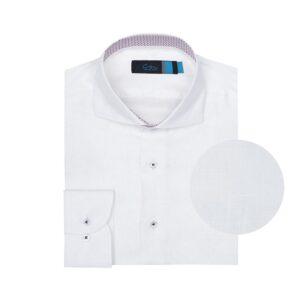 Camisa blanca en lino. Silueta relajada y cuello clásico corto con button under.